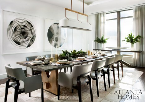 A pair of watercolors by Don Cooper, represented by Sandler Hudson, are a commanding presence in the dining room. The Jiun Ho light fixture and dining table, Caste armchairs in Holly Hunt leather, Jean de Merry console and Kyle Bunting rug are through R Hughes.