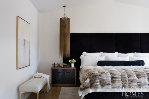 The new master wing is the epitome of comfortable luxury. The Björk Studio-designed headboard is a luxe alpaca fabric by Holly Hunt; it's complemented by custom Grey Furniture nightstands and a chain pendant from Arteriors.