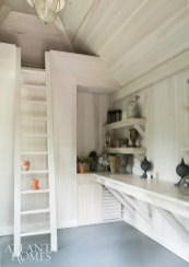 A functioning potting shed near the swimming pool, complete with running water and loads of seasonal storage, was created for the homeowners, who are active gardeners, by Harrison Design and McGarrity-Garcia.