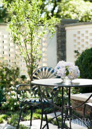 An outdoor fountain and seating arrangement—reminiscent of a spa setting—is accessed from the master suite, a wish-list item from the homeowners.