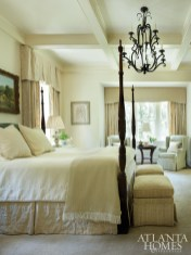 In the master bedroom and bath, custom draperies in a luxe Cowtan & Tout fabric frame garden views.