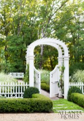 A graceful gated archway offers entrée into the formal perennial garden. The lush backyard was the vision of landscape architect Alec Michaelides, principal of Land Plus Associates.