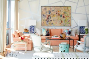 """""""It was so much fun to work on this project, in large part because the clients were very involved in terms of pushing the envelope,"""" says designer Margaret Kirkland. A sizable modern painting over the sofa influenced the color palette of the kinetic living room. """"They have a house in the California desert and go to a great art show every spring,"""" she says of the homeowners. """"They come back with all kinds of fun finds."""" In fact, the coral Rogers & Goffigon glazed linen used on the upholstery was largely inspired by their beloved California-cool vibes."""
