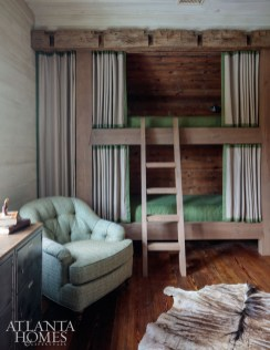 Upstairs, two bunk rooms sleep as many as 11 people. Millner and Charlotte, North Carolina, builder John Boyte created character-rich details in each of these spaces with vintage lumber architectural detailing from Willis Everett of Vintage Lumber.