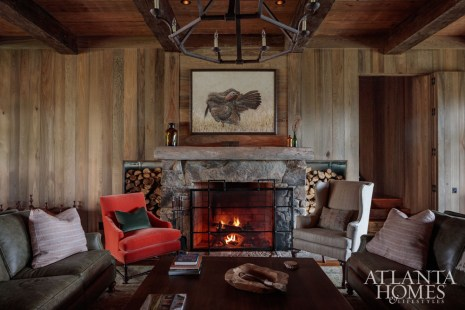 Zinc-lined bins on either side of the local stone mantel elegantly store stashes of firewood. Millner injected the personality of the lady of the house into the main living area in the form of the salmon-hued mohair chair near the fire.