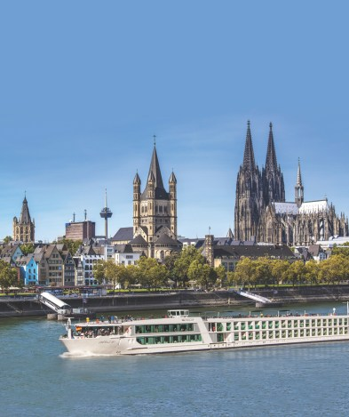 An Emerald ship sails through Cologne past the Dom, Germany's most visited cathedral.