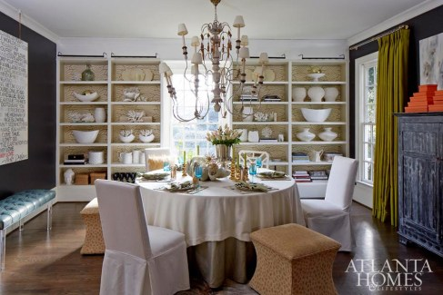 The dining room's seating arrangement captures eclectic spirit of homeowner and decorator Jennifer Schoenberger's signature style. She selected the vibrant taffeta drapes after falling hard for them when she placed them in a client's home.
