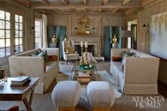 To add some soft contrast to the living room's existing floor-to-ceiling pecky cypress woodwork, Schoenberger selected a serene palette that was inspired by rocks she collected during a stroll along the beach in San Francisco.