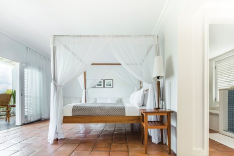 Teak and linen combine to create a tropical, tranquil design for an ocean-facing Terrace Room.