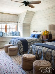 A guest room shows off pattern play between the bed spreads and the indoor-outdoor rug.