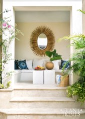 A mirror from Bungalow Classic takes center stage in the pool cabana.