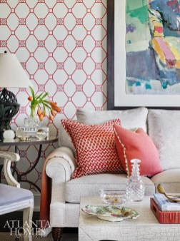 The living room features a mix of neutrals and bold color, seen in the pillow fabrics, Nina Campbell wallcovering and fine art. The energetic abstract is from Tew Galleries in Atlanta.