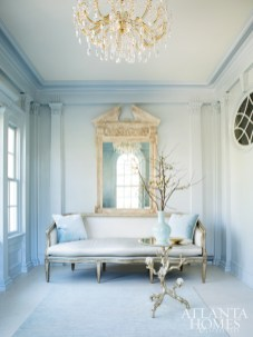A lush Dennis & Leen settee and pediment mirror set the tone in the formal side entry.