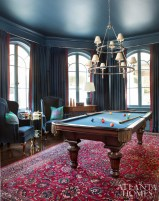Because the Magruders entertain often, it was important to them that the navy lacquered billiard room be on the main floor. Drapery fabric, Nancy Corzine, with trim by Samuel & Sons through Ainsworth-Noah. Navy lamp, Joseph Konrad. Convex mirror, Parc Monceau.