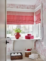Designers Guild wallpaper featuring hot-air balloons brings a dose of whimsy to the first-floor laundry room.
