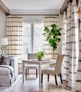 Horizontal striped draperies adds a lightness to the living room.