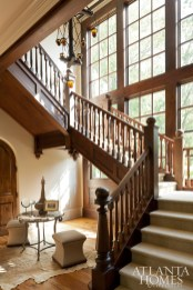 This dramatic staircase, with its handsome mahogany banister and soaring windows, lead to the five bedrooms, all located upstairs. The steps are outfitted with neutral carpet to warm up the space and soften the clatter of tiny feet and paws.