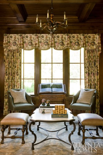 Located upstairs, the master study, lined with walnut paneling, is outfitted with a pair of Sherrill Furniture side chairs, as well as two benches from English Accent Antiques that were reupholstered in Crest Leather, perfect perches for a competitive game of chess.