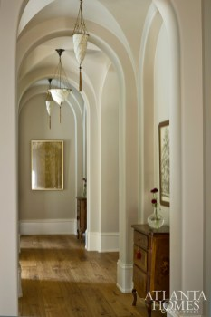 Architect Bill Harrison and builder Rick Fierer designed and constructed, respectively, the home's dynamic architectural details, including the arched hallways throughout.