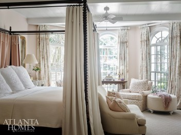Lanham swathed the master bedroom in a dusky apricot palette. She used an English floral print from Lee Jofa for the draperies.