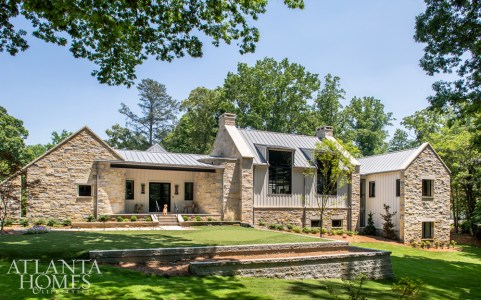 The 6,800-square-foot, five-bedroom/six-bath home includes an on-site office. The exterior combines classic farmhouse details, like board-and-batten siding, with modern layers, including a zinc roof, steel windows and limestone.