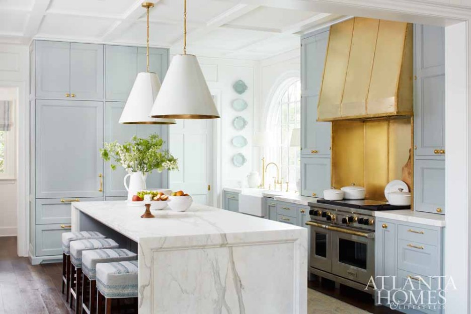 Light Blue and white kitchen with gold accents
