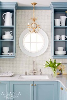 """""""We gave the homeowners the function of a large kitchen by incorporating smart design and storage selections while still paying homage to the architecture and legacy of the home."""" —Matthew Quinn"""