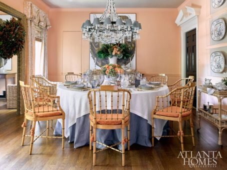Serena & Lily's Isleboro chairs sit pretty between Fortuny draperies. Wreath by Weston Farms. Florals by Danielle Rollins.