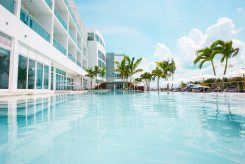 The ground-floor Lagoon Pool offers up-close views of the Mega Yacht Marina. above Resorts World Bimini sprawls 750 acres and offers guests impressive beachfront views.