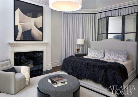 """Although the master bedroom wasn't initially marked for redecoration, ultimately it, too, received the Musso touch. A tall drapery panel, a mirrored screen from Logan Gardens and an undulating headboard created a tiered effect. """"We love the idea of playing with layers rather than strong pattern to add interest,"""" says van den Bergh. The architectural photograph is by Anderson & Low from Jackson Fine Art."""