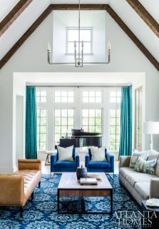 A bay of windows in the great room creates a jewel box effect for a niche that houses the grand piano.