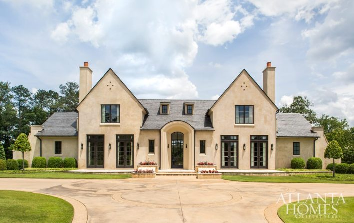 """""""The house is inspired by C.F.A. Voysey, the modernist architect of his day,"""" says Kemp. """"The design embraces simple roof lines and side buttresses, which extend the home beyond the walls, reaching out elegantly and embracing the site."""""""