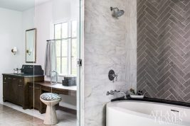 The smartly designed wet area of the master bathroom encloses both the soaking tub and shower in glass.