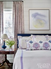 Dewberry devised a fresh navy and lavender palette for the guest bedroom. The glazed-linen drapery features a damask pattern by Bailey & Griffin, and the bedding is by Jane Wilner.