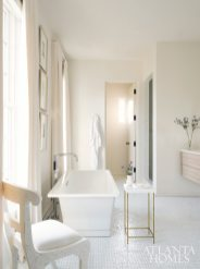 The guest bath is awash with white.