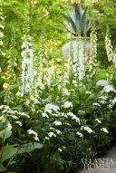 A perennial garden includes 'Emerson' white foxglove and white delphinium.