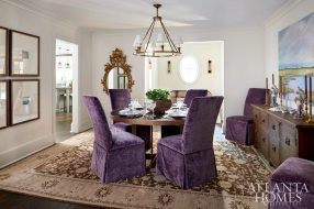 """""""Mary Kate wanted this house to have a more bohemian and collected look,"""" says Woodbery. Dining chairs upholstered in a Pierre Frey velvet and contemporary artwork by Sunny Goode add punch to a scheme that includes a Moattar rug, antique buffet from Bungalow Classic and custom Bradley dining table."""