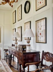 """While the house has formal elements and antiques, it is still very comfortable and livable,"" says Izlar. The framed waxed seals are from A. Tyner."