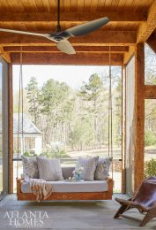 Another example of the homeowner's handiwork is a back porch swing featuring intricate details; it also provides an idyllic spot to lounge or to visit with friends and family.
