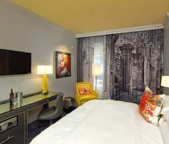 Guest rooms at the Grand Bohemian Hotel Charleston feature original artwork.