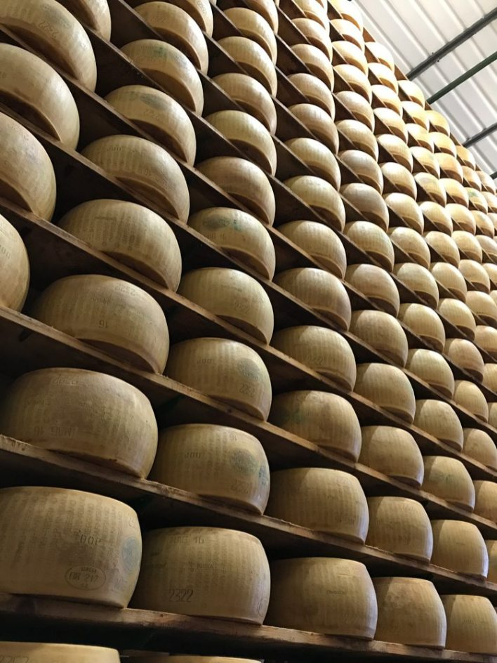 Parma's famous Parmigiano Reggiano cheese is aged in towering storerooms.
