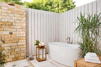 Enjoy a soak in a luxurious outdoor tub at one of Sailrock's beachfront villas.