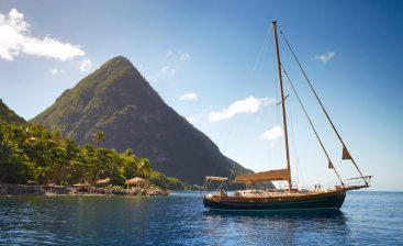 The boating lifestyle is celebrated at Jalousie Bay, with Gros Piton scraping the sky beyond.