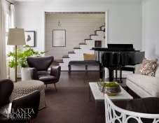 The gracious living room is a symphony of dark and light.