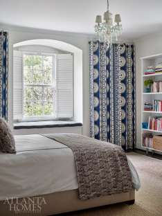 Lilly's bedroom includes draperies made from a Schumacher fabric and a batik duvet from one of Vivian's favorite places to stay, the Hotel San Jose in Austin.