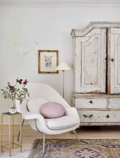 Drawn to items with character, the Swedish armoire (purchased from an antique dealer in Dallas) is among McBrearty's most prized pieces. The womb chair is upholstered in a boiled wool from Holland & Sherry and the leather pillow is Jerry Pair Leather.