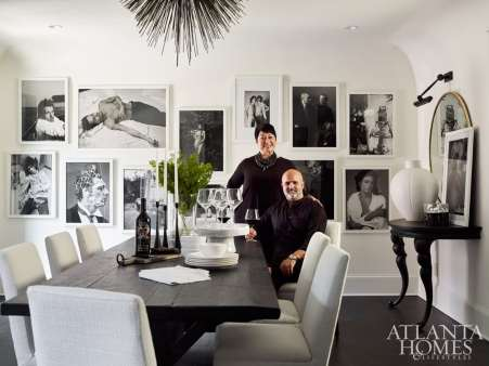 The dining room features a weathered trestle table, nubby Parsons-style chairs, framed black-and-white photography prints by Annie Leibovitz and Jean de Merry's Lumiere chandelier.