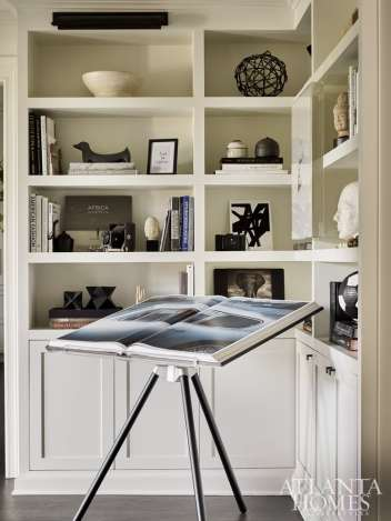 Compelling objets d'art and collections of books show off Kelly's signature monochromatic palette.