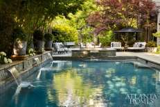 After spending more than two decades building their careers in both the design and hospitality fields, the Anthony's—who are pioneering change in Atlanta's evolving hospitality scene—have finally found (and fashioned) a home where they can host friends and associates. In their lush new landscape, the pool is punctuated by hydrangea and boxwood planters, while a newly added cabana, jacuzzi, fire pit, South African-style braai—like the one at Justin's Cape Dutch restaurant—a Big Green Egg, a well-equipped outdoor kitchen from Guy Gunter Home, and seating groups set in the shade of a Japanese maple collectively serve every entertaining whim.