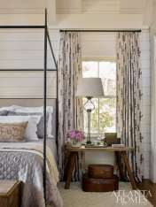 """Westbrook aimed for a lighter and brighter feel in the master bedroom while also abiding by her design philosophy that """"bedrooms should always feel a bit more elegant than the rest of the home."""" She achieved this with delicate accents and antique pieces. The bed is Kerry Joyce through Ainsworth-Noah."""